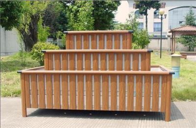 供应新型户外建材氟碳木纹酒店仿木花坛